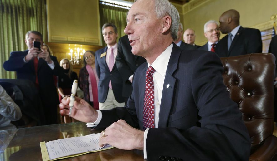 Arkansas Gov. Asa Hutchinson speaks as he prepares to sign a bill providing a state income tax cut, Friday, Feb. 6, 2015, in the Governor's Conference Room at the state Capitol in Little Rock, Ark. (AP Photo/Danny Johnston)