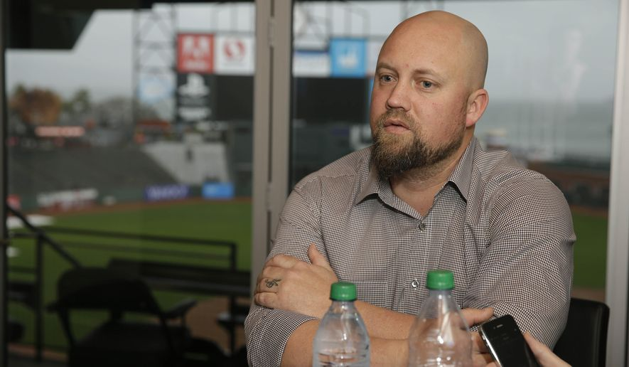 San Francisco Giants new third baseman Casey McGehee answers questions during a media availability at AT&T Park Friday, Feb. 6, 2015, in San Francisco. McGehee played last season for Miami. (AP Photo/Eric Risberg)