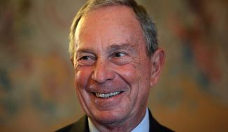 In this Sept. 16, 2014, file photo, former New York Mayor Michael Bloomberg smiles prior to be conferred with the Chevalier de la Legion d'Honneur by France's Foreign minister Laurent Fabius, at the Quai d'Orsay, in Paris. (AP Photo/Thibault Camus, File)