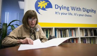 In this file photo, Linda Jarrett reads through notes at Dying with Dignity offices in Toronto, Friday, Feb. 6, 2015. On Feb. 14, 2018, a terminally ill Canadian man named Roger Foley filed a lawsuit against his hospital, several governmental agencies and the attorneys general of Ontario and Canada, claiming he was denied proper medical care and offered assisted suicide instead. (AP Photo/The Canadian Press, Chris Young) **FILE**