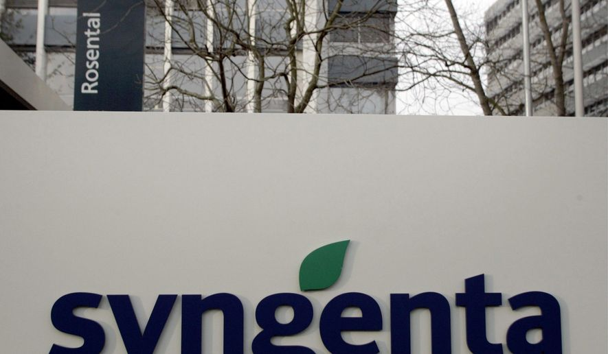 FILE - In this Feb. 7, 2007 file photo is the headquarters and logo of the Swiss chemical maker Syngenta in Basel, Switzerland. More than 360 lawsuits have been filed by farmers and farm businesses in U.S. 20 states in a legal dispute centering around Syngenta's sale of a corn seed called Agrisure Viptera, which was genetically altered to contain a protein that kills corn-eating bugs such as earworms and cutworms. (AP Photo/Keystone, Georgios Kefalas, file)
