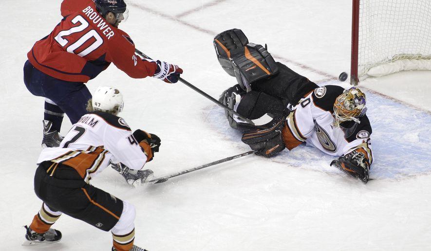 Anaheim Ducks goalie Ilya Bryzgalov, of Russia, blocks a shot by Washington Capitals' Troy Brouwer (20) as Anaheim Ducks' Hampus Lindholm (47), of Sweden, defends during the second period of an NHL hockey game, Friday, Feb. 6, 2015, in Washington. (AP Photo/Luis M. Alvarez)