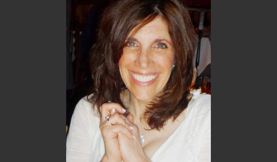 This photo provided by the Brody family shows an undated photo of Ellen Brody who was killed in the SUV that was hit by a Metro-North commuter train in Vahalla, N.Y, Tuesday Feb. 3, 2015. The National Transportation Safety Board is looking into how familiar the SUV driver was with her car and her route, whether she was using a cellphone and whether the backed-up traffic played a role. (AP Photo/Family photo via Jeff Schaeffer)