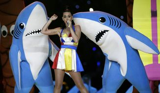 FILE - In this Feb. 1, 2015, file photo, singer Katy Perry performs during halftime of the NFL Super Bowl XLIX football game in Glendale, Ariz. The dancing sharks that stole some of the spotlight during Perry's Super Bowl halftime show have taken a bite out of an artist's bid to sell small figurines of them. (AP Photo/David J. Phillip, File)