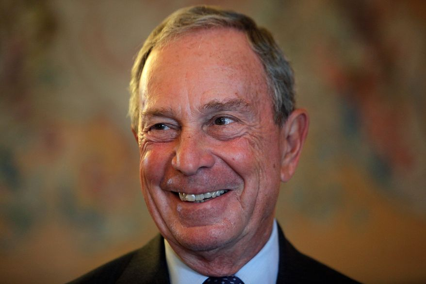 Former New York Mayor Michael Bloomberg smiles prior to be conferred with the Chevalier de la Legion d'Honneur by France's Foreign minister Laurent Fabius, at the Quai d'Orsay, in Paris, in this Sept. 16, 2014, file photo. (AP Photo/Thibault Camus, File)