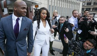 Adrian Peterson and his wife Ashley greet fans outside the federal court house, Friday, Feb. 6, 2015 in Minneapolis. The NFL Players Association's attempt to have Minnesota Vikings running back Adrian Peterson reinstated has been taken under advisement by a federal judge. U.S. District Judge David Doty heard arguments from the NFLPA and the NFL on Friday. (AP Photo/Star Tribune, Brian Peterson)  MANDATORY CREDIT; ST. PAUL PIONEER PRESS OUT; MAGS OUT; TWIN CITIES LOCAL TELEVISION OUT