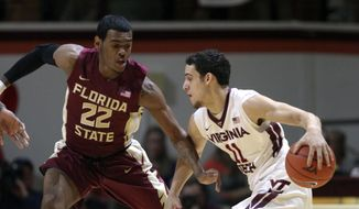 Virginia's Tech's Devin Wilson (11) drives on Florida State's Xavier Rathan-Mayes (22) during the first half action of an NCAA basketball game in Blacksburg, Va. Saturday Feb. 7, 2015. (AP Photo/The Roanoke Times, Matt Gentry)  LOCAL TELEVISION OUT; SALEM TIMES REGISTER OUT; FINCASTLE HERALD OUT;  CHRISTIANBURG NEWS MESSENGER OUT; RADFORD NEWS JOURNAL OUT; ROANOKE STAR SENTINEL OUT
