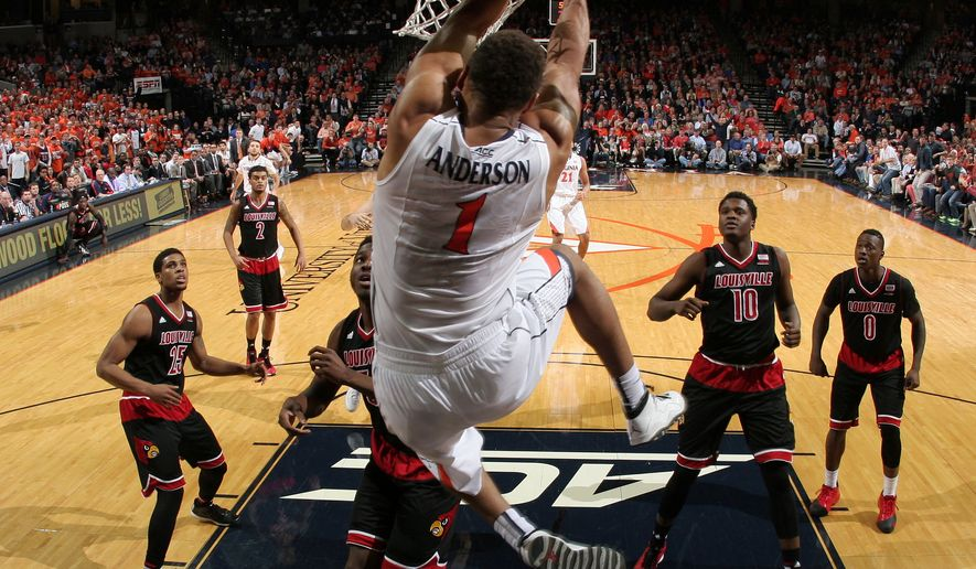 Louisville defenders watch as Virginia guard Justin Anderson (1) dunks the ball during the second half of an NCAA college basketball game Saturday Feb. 7, 2015, in Charlottesville, Va. Virginia defeated Louisville 52-47. (AP Photo/Andrew Shurtleff)