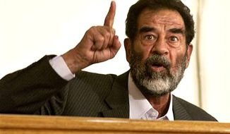 The late Iraqi dictator Saddam Hussein. (Associated Press) ** FILE **