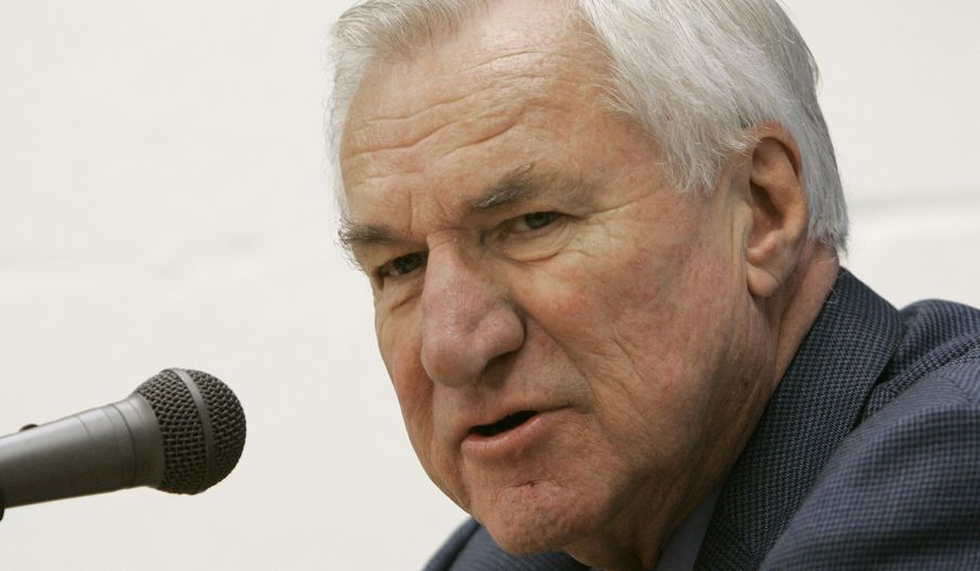 "FILE - In this Dec. 8, 2006 file photo, former North Carolina basketball coach Dean Smith answers questions during a press conference in Chapel Hill, N.C. Smith, the North Carolina basketball coaching great who won two national championships, died ""peacefully"" at his home Saturday night, Feb. 7, 2015, the school said in a statement Sunday from Smith's family. He was 83. (AP Photo/Gerry Broome, File)"