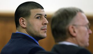 Former New England Patriots football player Aaron Hernandez sits with his defense attorney Charles Rankin during the afternoon session of his murder trial Friday, Feb. 6, 2015, in Fall River, Mass. Hernandez is charged with killing semiprofessional football player Odin Lloyd. The jury toured several sites related to the case earlier in the day, including Hernandez's home, Lloyd's home, and the industrial park where Lloyd's body was found. (AP Photo/Steven Senne, Pool)