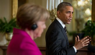President Obama and German Chancellor Angela Merkel are taking opposing tacks on Ukraine's ongoing faceoff with Russia, with Mr. Obama taking a hard-line stance and Mrs. Merkel seeking a diplomatic solution. (Associated Press)
