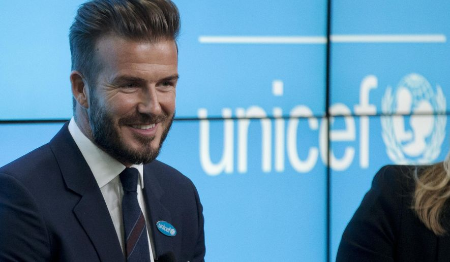 Former English national soccer team captain David Beckham speaks during a press conference to mark his 10 years as a goodwill ambassador for UNICEF and to launch '7' a new fund for children in danger across the globe in London, Monday, Feb. 9, 2015.  (AP Photo/Matt Dunham)