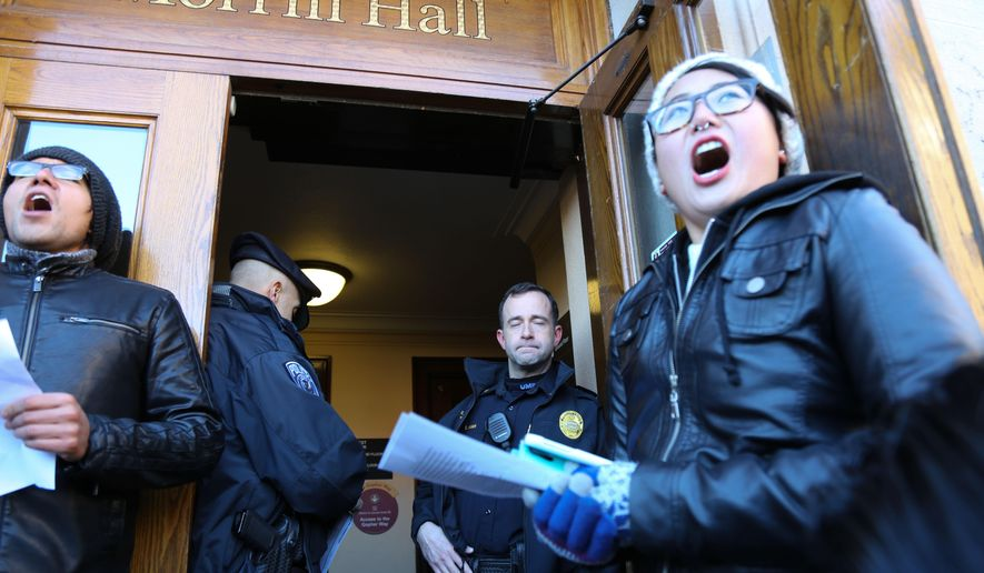 "Who's Diversity? organizer Tori Hong led a group of protesters demanding access to Morrill Hall as student protesters with the group Who's Diversity? occupied the offices of University of Minnesota president Eric Kaler on Monday, Feb. 9, 2015. University spokesman Steve Henneberry says 10 to 15 students were in Kaler's second-floor office in Morrill Hall on Monday ""having a conversation with the president and other senior leaders."" (AP Photo/The Star Tribune, Mark Vancleave)"