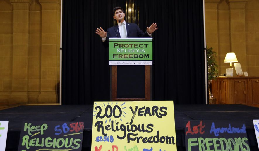 """Rep. Timothy Wesco, R-Osceola, addresses a rally of supporters of a religious freedom bill at the Statehouse in Indianapolis, Monday, Feb. 9, 2015. Weson is the author of the bill that the Senate Judiciary Committee will hold a hearing on later in the day. The Republican-sponsored proposal would prohibit any state laws that """"substantially burden"""" a person's ability to follow his or her religious beliefs and extends the definition of a """"person"""" to include religious institutions, businesses and associations. (AP Photo/Michael Conroy)"""