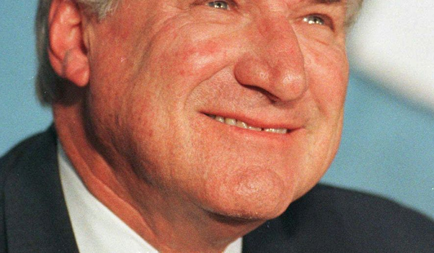 """FILE - In an Oct. 9, 1997 file photo, North Carolina basketball coach Dean Smith smiles during a news conference in Chapel Hill, N.C.,where he announced his retirement. Smith, the North Carolina basketball coaching great who won two national championships, died """"peacefully"""" at his home Saturday night, Feb. 7, 2015, the school said in a statement Sunday from Smith's family. He was 83. (AP Photo/Bob Jordan, File)"""