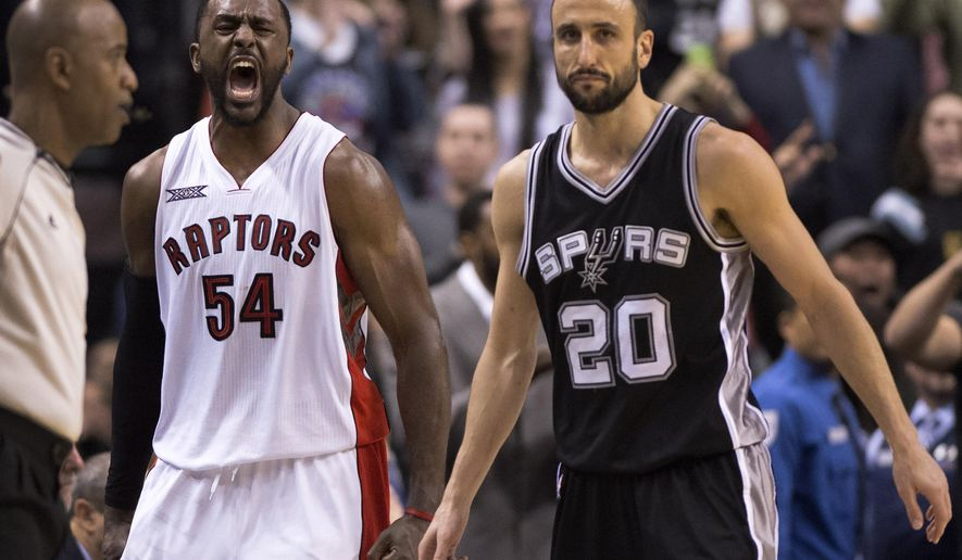 Toronto Raptors forward Patrick Patterson (54) celebrates as San Antonio Spurs' Manu Ginobili looks on in the waning seconds of their NBA basketball game, Sunday, Feb. 8, 2015, in Toronto. Toronto's 87-82 victory denied Spurs' head coach Gregg Popovich his 1,000th win. (AP Photo/The Canadian Press, Frank Gunn)