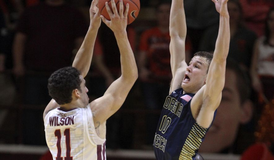 Devin Wilson (11) of Virginia Tech looks to shoot past the defense of Georgia Tech's Travis Jorgenson (10) during first half action of the NCAA basketball game in Blacksburg, Va., Monday, Feb. 9, 2015. (AP Photo / The Roanoke Times, Matt Gentry)    LOCAL TELEVISION OUT; SALEM TIMES REGISTER OUT; FINCASTLE HERALD OUT;  CHRISTIANBURG NEWS MESSENGER OUT; RADFORD NEWS JOURNAL OUT; ROANOKE STAR SENTINEL OUT