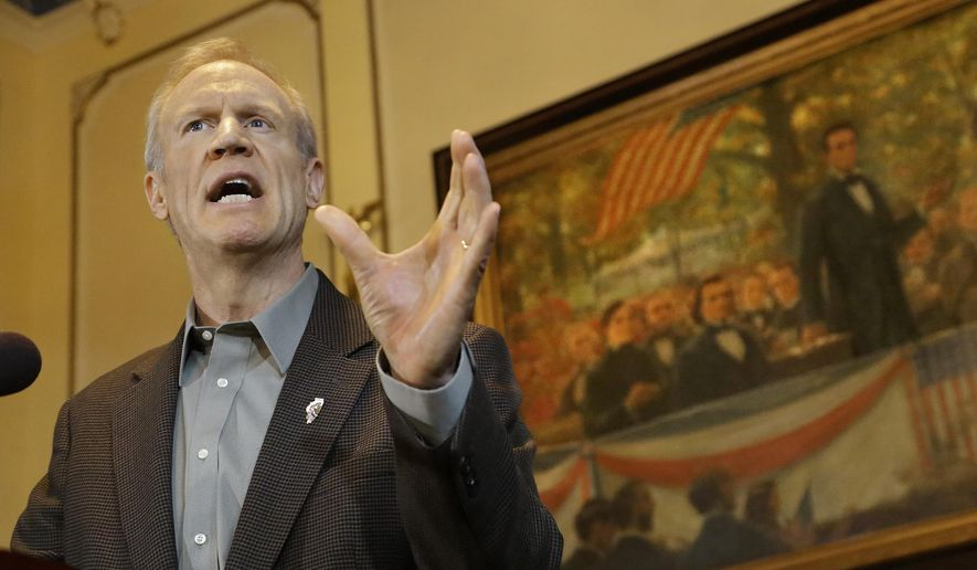"Illinois Gov. Bruce Rauner speaks to reporters during a news conference in his office at the Illinois State Capitol Monday, Feb. 9, 2015, in Springfield, Ill. Rauner stepped up his campaign against government employee unions by eliminating so-called ""fair share"" dues paid by workers who don't join a union. (AP Photo/Seth Perlman)"