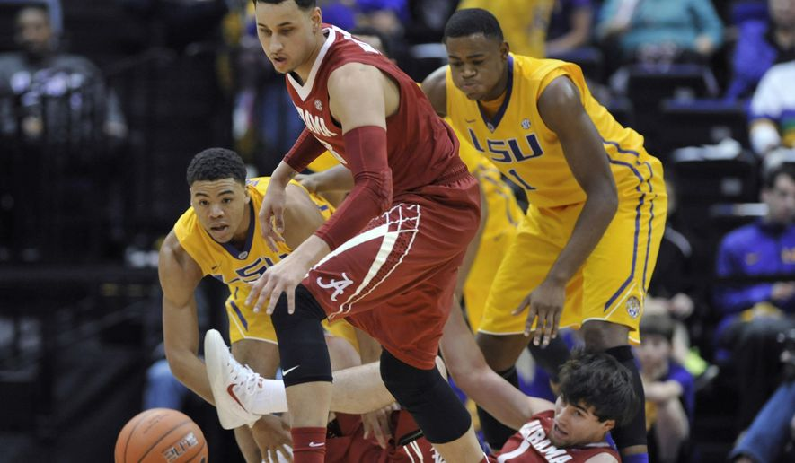 LSU's Jalyn Patterson, left, and Jarell Martin, right, and Alabama's Michael Kessens, center, go after the ball after it was lost on the Alabama offensive end by Riley Norris, on ground, during the first half of an NCAA college basketball game Saturday, Feb. 7, 2015, in Baton Rouge, La. (AP Photo/The Baton Rouge Advocate, Travis Spradling)