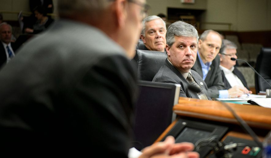 Minnesota Management and Budget Commissioner Myron Frans faced tough questioning from Rep. Steve Drazkowski, center, at the House Ways and Means Committee hearing about Gov. Mark Dayton's raises for commissioners, Monday, Feb. 9, 2015, in St. Paul, Minn.. The committee approved Drazkowski's amendment that would reduce deficiency funding for state agencies by the amount of the raises approved for the commissioners of those agencies.   (AP Photo/Star Tribune, Glen Stubbe)  MANDATORY CREDIT; ST. PAUL PIONEER PRESS OUT; MAGS OUT; TWIN CITIES LOCAL TELEVISION OUT