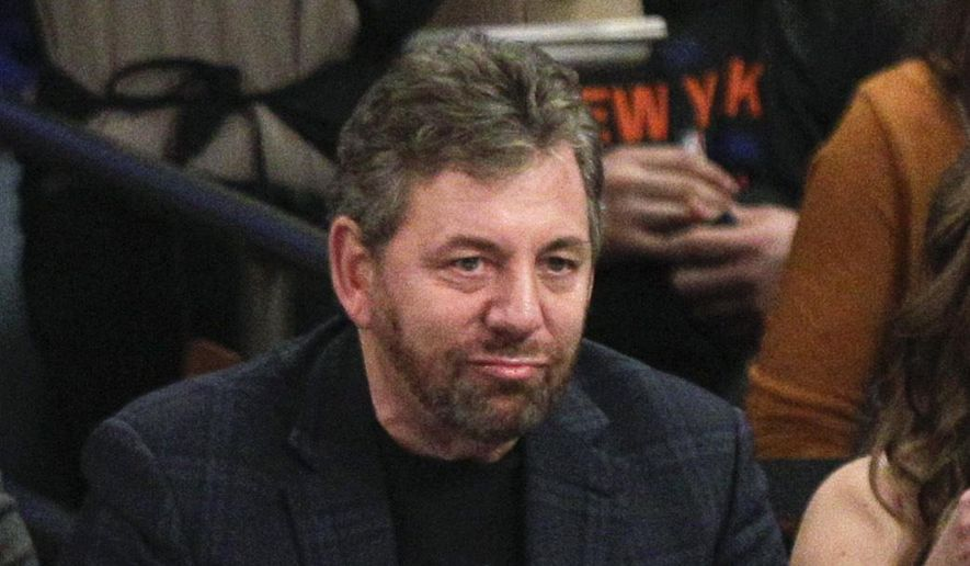 Madison Square Garden chairman James Dolan watches the first half of an NBA basketball game between the New York Knicks and the Golden State Warriors on Saturday, Feb. 7, 2015, in New York. (AP Photo/Frank Franklin II)
