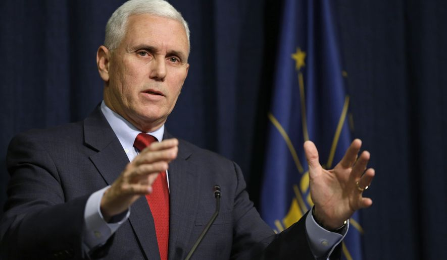 Indiana Gov. Mike Pence announces that he has signed an executive order to shorten the ISTEP+ exam to lessen the burden on students, their parents and teachers during a press conference at the Statehouse in Indianapolis, Monday, Feb. 9, 2015. (AP Photo/Michael Conroy)
