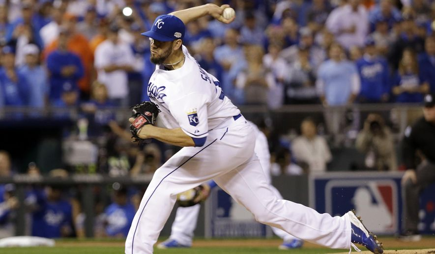 FILE - In this Oct. 21, 2014, file photo, Kansas City Royals pitcher James Shields throws during the first inning of Game 1 of baseball's World Series against the San Francisco Giants in Kansas City, Mo. Right-hander James Shields, who helped Kansas City reach the World Series last season, has agreed to a four-year contract with the San Diego Padres. (AP Photo/David J. Phillip, File)