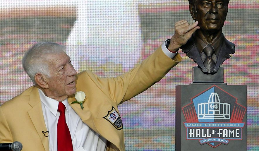 FILE- In this Aug. 6, 2011, file photo, Ed Sabol touches a bust of himself after it was unveiled during the induction ceremony at the Pro Football Hall of Fame in Canton, Ohio. Sabol, the NFL Films founder who revolutionized sports broadcasting and transformed pro football from an up-and-coming sport to must-watch theater died Monday, Feb. 9, 2015, the league said. He was 98. (AP Photo/Ron Schwane, File)