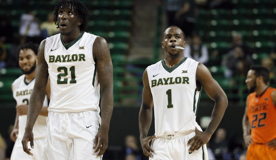 Baylor's Taurean Prince (21) and Kenny Chery (1) walk up court in front of Oklahoma State's Jeff Newberry (22) in the final seconds of the second half of an NCAA college basketball game Monday, Feb. 9, 2015, in Waco, Texas. Oklahoma state won 74-65.  (AP Photo/Tony Gutierrez)