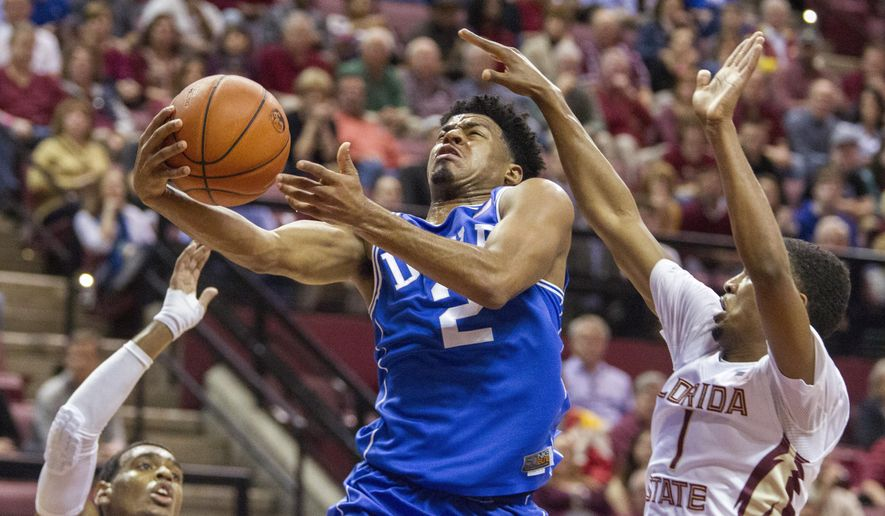 Duke guard Quinn Cook beats Florida State's Devon Bookert to the basket in the first half of an NCAA college basketball game in Tallahassee, Fla., Monday, Feb. 9, 2015. (AP Photo/Mark Wallheiser)