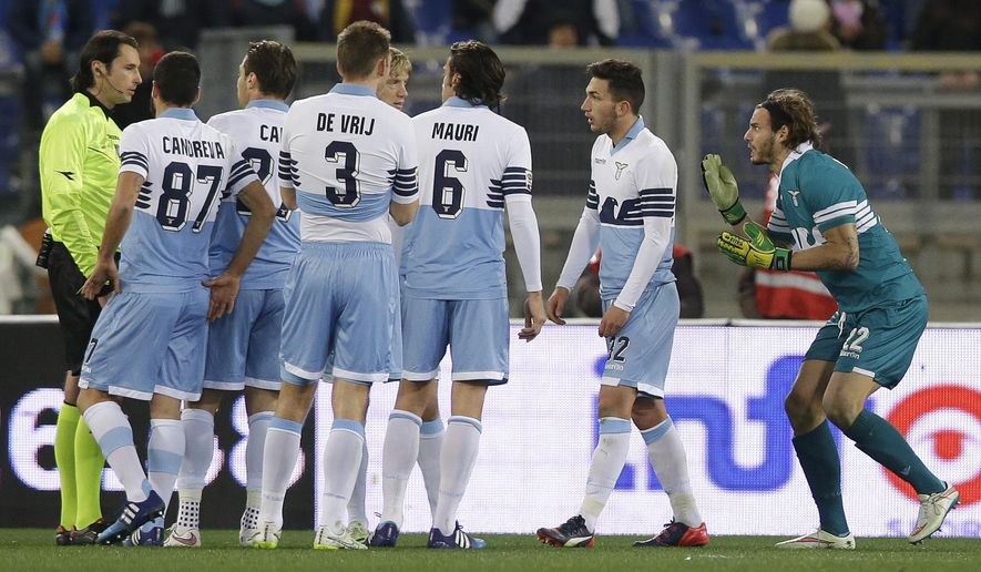 Lazio's goalie Federico Marchetti, right, argues with referee Andrea Gervasoni, left, after being shown a red card during a Serie A soccer match between Lazio and Genoa at Rome's Olympic stadium, Monday, Feb. 9, 2015. (AP Photo/Gregorio Borgia)