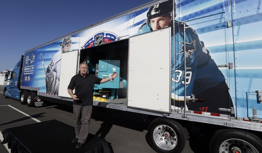 NHL senior director of facilities and hockey operations Dan Craig displays a 53-foot trailer housing ice-making and ice-monitoring equipment used to create an ice sheet for hockey games outside of Levi's Stadium Monday, Feb. 9, 2015, in San Jose, Calif. The San Jose Sharks and Los Angeles Kings will play in an outdoor NHL hockey game at Levi's Stadium on Feb. 21. (AP Photo/Marcio Jose Sanchez)