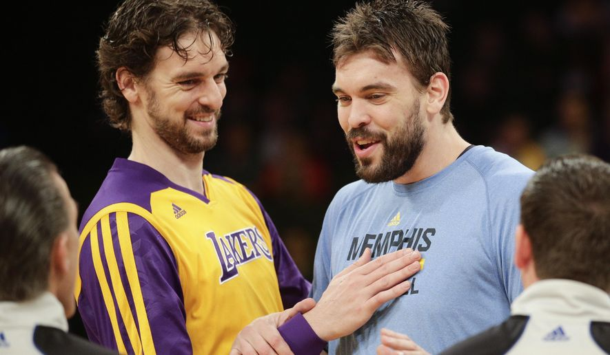 FILE - In this Nov. 15, 2013, file photo, Los Angeles Lakers' Pau Gasol, left, and his brother, Memphis Grizzlies' Marc Gasol talk to referees before an NBA basketball game in Los Angeles. Pau and Marc Gasol will make history Sunday, Feb. 15, 2015,  when the Spanish centers become the first brothers to start against each other in the NBA All-Star game.  (AP Photo/Jae C. Hong, File)