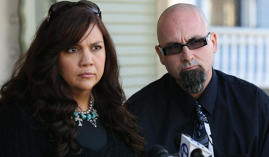 Erik Coignard, right, and his wife Beth Coignard meet with their attorney Tim Maloney of San Antonio at  his law office in San Antonio concerning a possible lawsuit involving the police shooting death of the Coignard's 17-year-old daughter Kristiana, being shot to death last month in the lobby of a Longview police station. Erik Coignard said Monday that he wants more information about the events that led up to his daughter's death. (AP Photo/The San Angelo Standard-Times, Bob Owen)