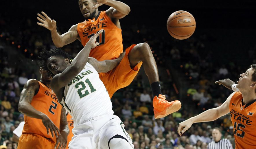 Baylor forward Taurean Prince (21) is fouled going to the basket by Oklahoma State's Michael Cobbins (20) as Le'Bryan Nash (2) and Christien Sager (15) watch in the first half of an NCAA college basketball game Monday, Feb. 9, 2015, in Waco, Texas. (AP Photo/Tony Gutierrez)
