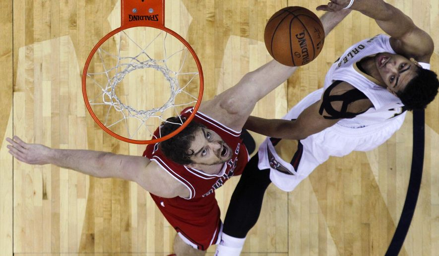 New Orleans Pelicans forward Anthony Davis, right, goes to the basket against Chicago Bulls forward Pau Gasol in the first half of an NBA basketball game in New Orleans, Saturday, Feb. 7, 2015. (AP Photo/Gerald Herbert)