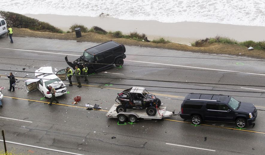 Los Angeles County Sheriff's deputies investigate the scene of a car crash where one person was killed and at least seven other's were injured, Saturday, Feb. 7, 2015. Olympic gold medalist Bruce Jenner was in one of the cars involved in the four-vehicle crash on the Pacific Coast Highway in Malibu, Calif., that killed a woman, Los Angeles County authorities said. (AP Photo/Ringo H.W. Chiu)