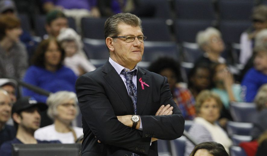 Connecticut's head coach Geno Auriemma watches as his team plays against Memphis in the first half of an NCAA college basketball game Saturday, Feb. 7, 2015, in Memphis, Tenn. (AP Photo/Karen Pulfer Focht)