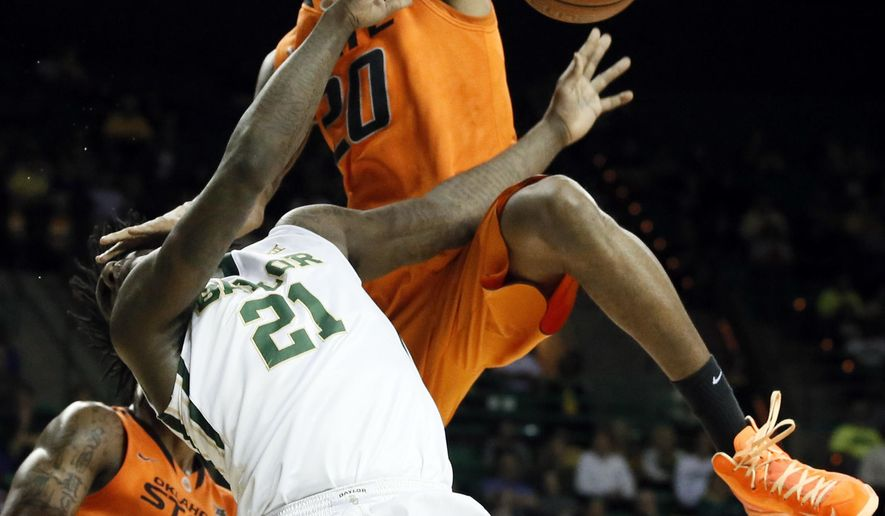 Baylor forward Taurean Prince (21) is fouled going to the basket by Oklahoma State's Michael Cobbins (20) as Le'Bryan Nash (2) watches in the first half of an NCAA college basketball game Monday, Feb. 9, 2015, in Waco, Texas. (AP Photo/Tony Gutierrez)