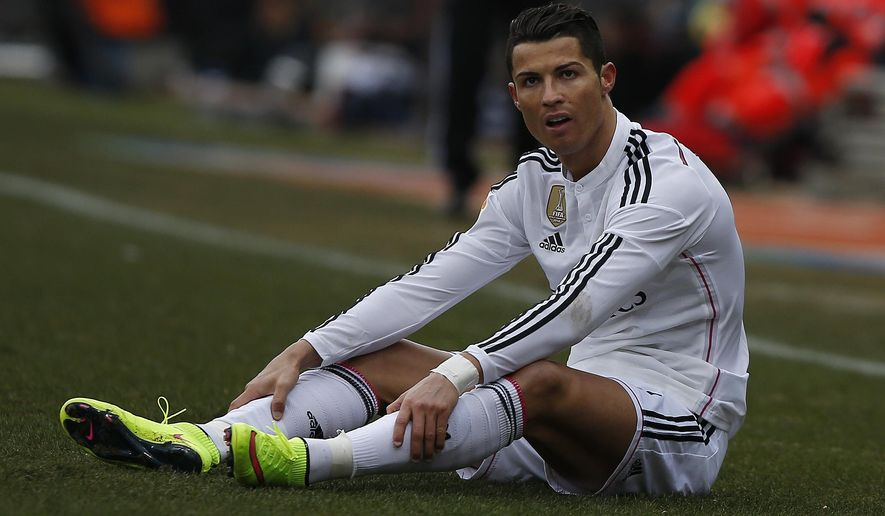 Real Madrid's Cristiano Ronaldo gestures during a Spanish La Liga soccer match between Atletico Madrid and Real Madrid at the Vicente Calderon stadium in Madrid, Spain, Saturday, Feb. 7, 2015. (AP Photo/Andres Kudacki)
