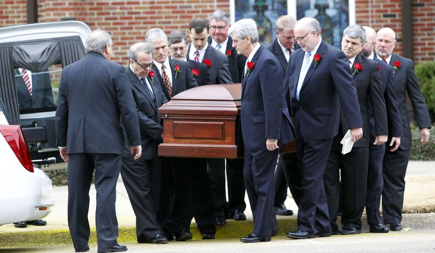 Gov. Phil Bryant, center, and the rest of the pallbearers carry the casket of Rep. Alan Nunnelee following the funeral ceremony on Monday, Feb. 9, 2015, at Calvary Baptist Church in Tupelo, Miss. More than 1,200 people packed the church to remember the third-term Republican congressman who died of a brain tumor Friday. He was 56. (AP Photo/The Northeast Mississippi Daily Journal, Thomas Wells)