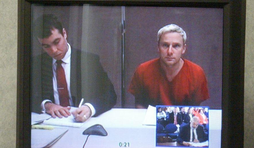 Sheboygan alderman Kevin MatiChek appears remotely by video teleconference Monday, Feb. 9, 2015, at the Sheboygan County courthouse. (AP Photo/Sheboygan Press, Justin Kabbes)