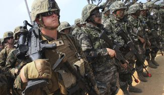 U.S. Marines and South Korean soldiers take part in the annual Cobra Gold military exercises on Hat Yao beach in Chonburi province, Thailand, on Feb. 14, 2014. (Associated Press)