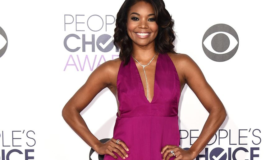 "FILE--In this Jan. 7, 2015 file photo, Gabrielle Union arrives at the People's Choice Awards at the Nokia Theatre in Los Angeles. Union stars in ""Being Mary Jane,"" airing Tuesdays on BET. (Photo by Jordan Strauss/Invision/AP, File)"