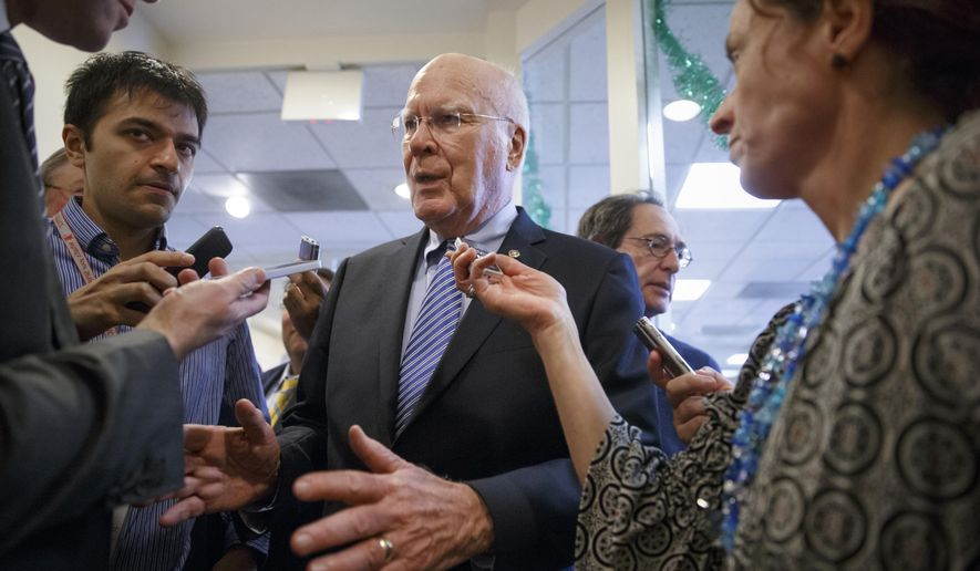 "FILE - In this Dec. 17, 2014 file photo, Sen. Patrick Leahy, D-Vt. speaks to reporters on Capitol Hill in Washington. Leahy, the Senate's most senior lawmaker said Tuesday he will skip the Israeli prime minister's speech to Congress next month on Iran, calling the invitation by Republicans without White House consultation a ""tawdry and high-handed stunt."" (AP Photo/J. Scott Applewhite, File)"