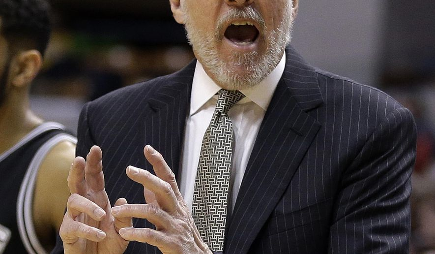 San Antonio Spurs head coach Gregg Popovich argues a call during the second half of an NBA basketball game against the Indiana Pacers Monday, Feb. 9, 2015, in Indianapolis. San Antonio won the game 95-93.  Popovich reached the 1,000-win milestone Monday night.  . (AP Photo/Darron Cummings)