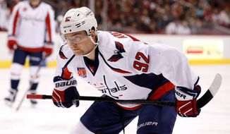 Washington Capitals' Evgeny Kuznetsov (92), of Russia, waits for the puck to drop during the first period of an NHL hockey game against the Arizona Coyotes Tuesday, Nov. 18, 2014, in Glendale, Ariz.  The Capitals defeated the Coyotes 2-1 in overtime. (AP Photo/Ross D. Franklin)