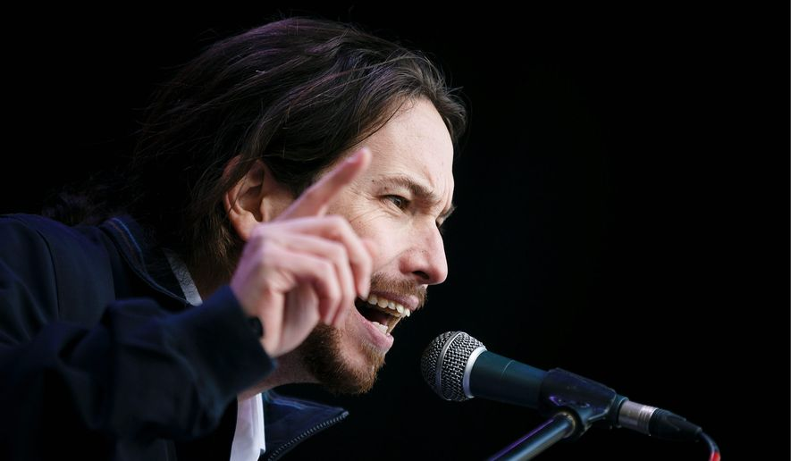 'Tick Tock' Pablo Iglesias, leader of Spanish Podemos party, says time is running out for unpopular austerity measures. He hopes to emulate the electoral success of Greece's Syriza party. (Associated Press)