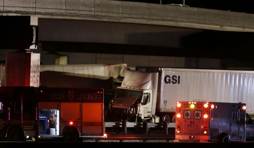 The scene of a multi-vehicle accident that closed the New Jersey Turnpike Monday, Feb. 9, 2015, near Cranbury, N.J. A highway pileup involving 15 or more vehicles including box trucks, tractor-trailers and a bus on Monday night left at least one person dead and several others injured. (AP Photo/Mel Evans)